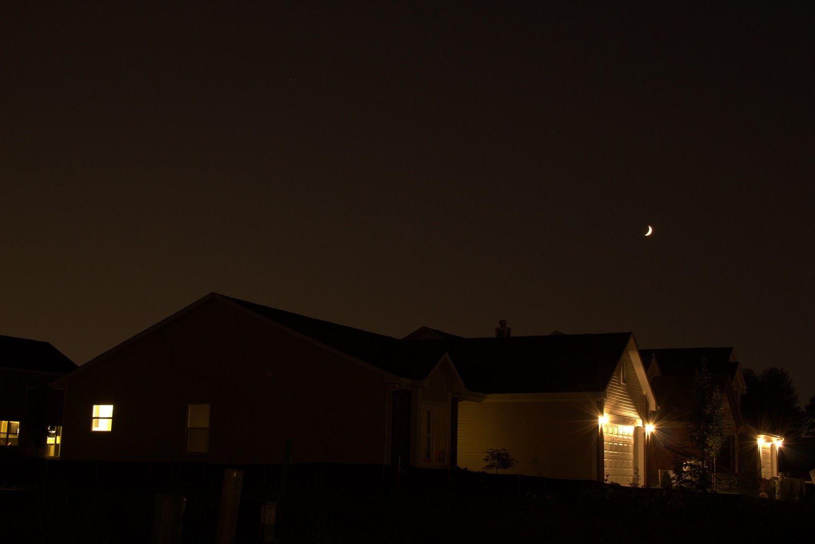 crescent moon over neighborhood