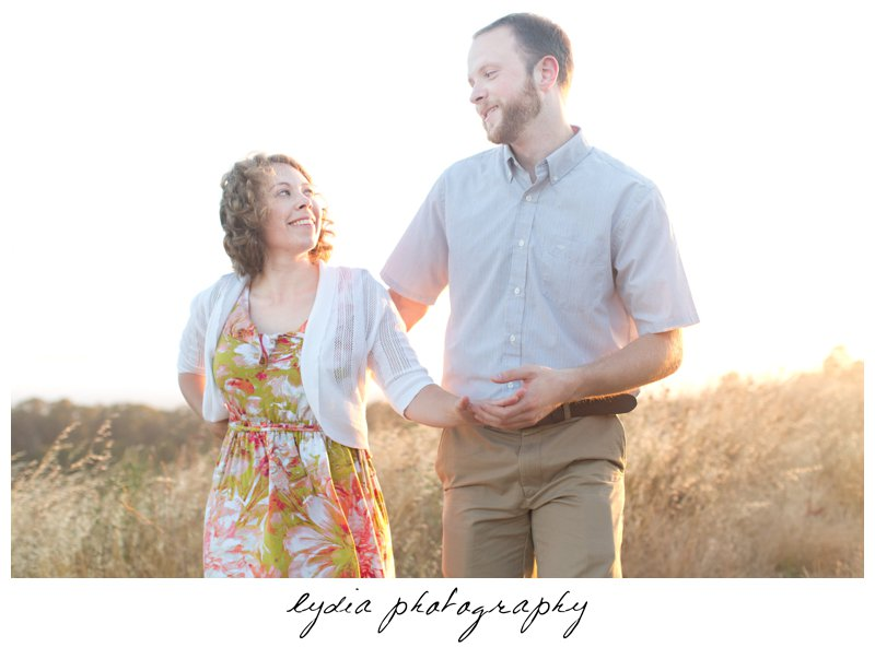 Bride and groom dancing in the hay at lifestyle engagement portraits in the Bay Area of California