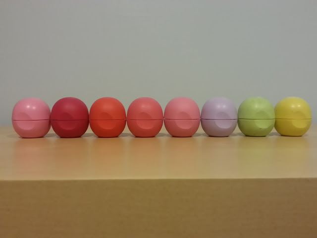 a collection of EOS lip balm