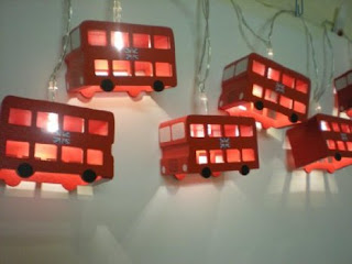 A set of 6 wooden red London Bus lights shown hanging up.