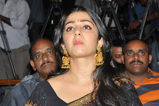 Actress Charmi Kaur Pictures in Black Saree at Jyothilakshmi Trailer Launch  47