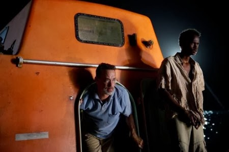 Tom Hanks escapes from a lifeboat in CAPTAIN PHILLIPS