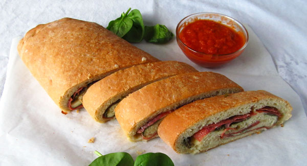 Salami, Spinach, and Mozzarella Pizza Roll with Spicy Marinara
