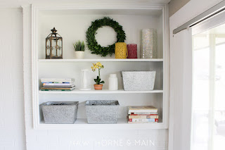painted brick fireplace and bookshelf makever