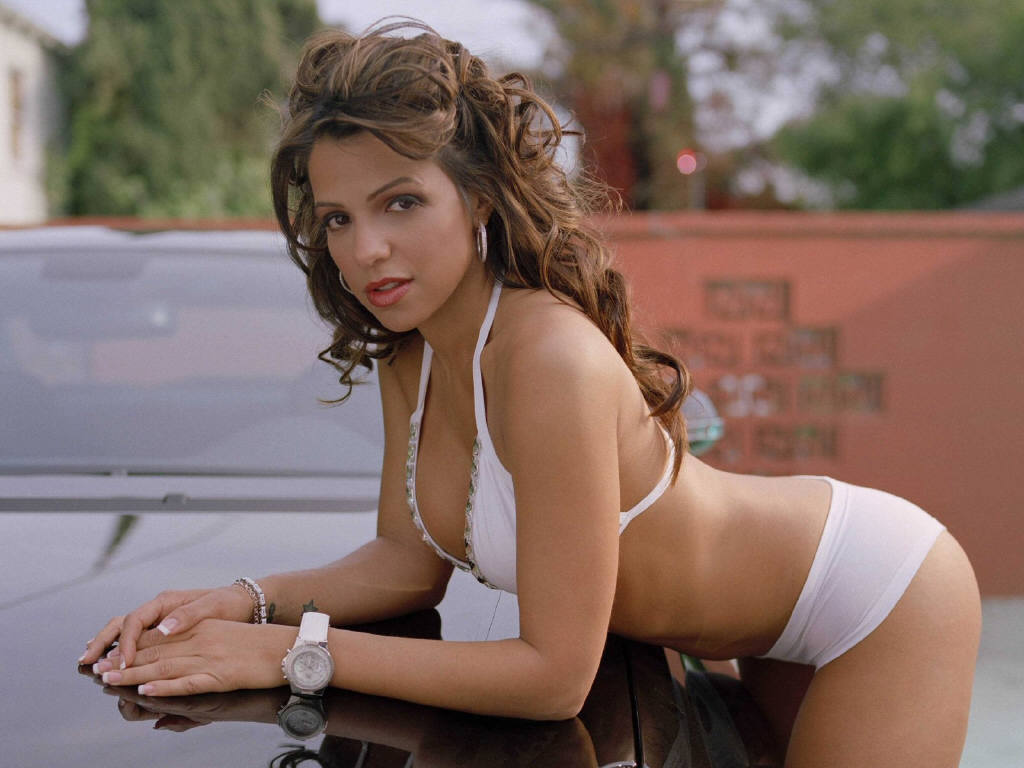 Vida Guerra Leaning Against a Car in a White Bikini Jennifer Aniston feeling broody