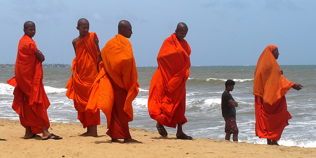 Sri Lankan Buddhist monks on the beach.