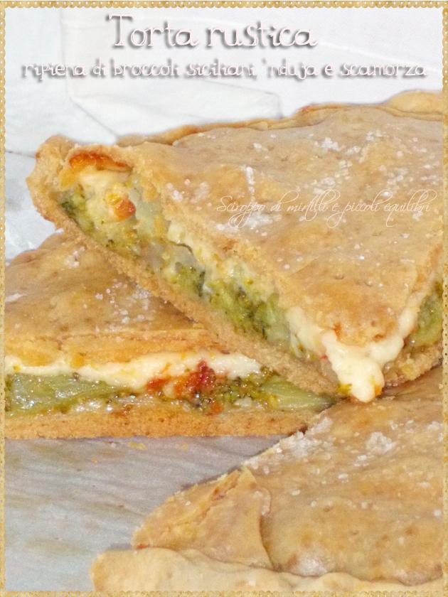 Torta rustica ripiena di broccoli siciliani, 'nduja e scamorza, fetta