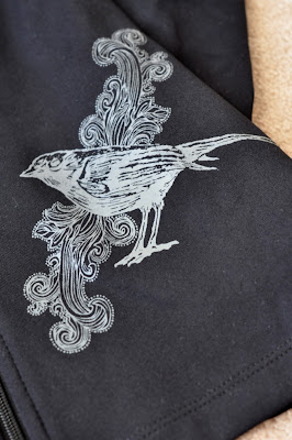 Bird Design Detail on Albion Fit's 26.2 Jacket in Black - Photo by Taste As You Go
