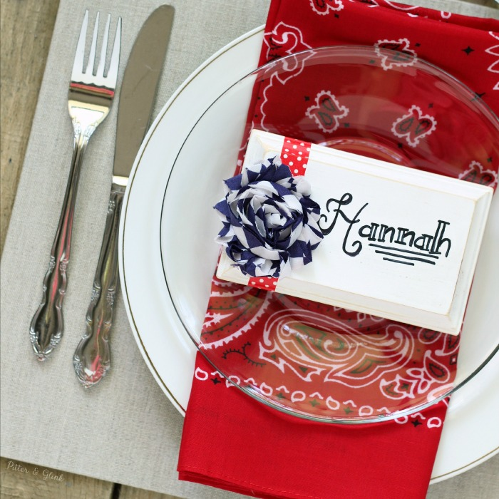 A red, white and blue place setting featuring wooden patriotic place cards. www.pitterandglink.com