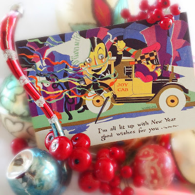 vintage style ornaments and holly berries surround 1920s art deco card with tuxedo man in yellow taxi