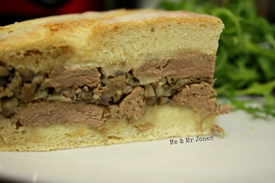 Shooter's sandwich - a pressed sandwich filled with steak and mushrooms