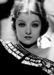 Vintage black and white photo of actress Myrna Loy