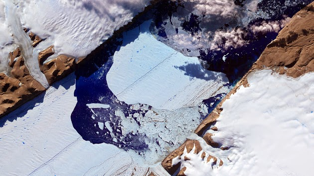 """A massive """"ice island"""" breaks free from the Petermann Glacier in Greenland in 2012. (Credit: Rex Features/AP) Click to enlarge."""