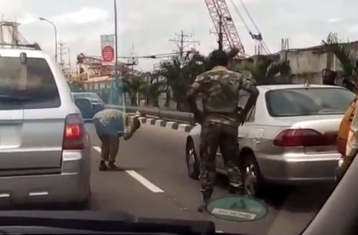 Photos: Military officer orders man to frog jump for scratching his car