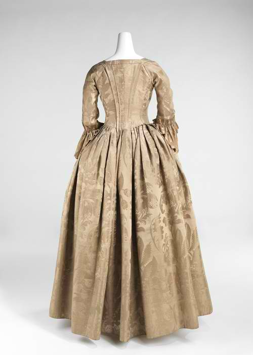 This lovely brown brocade wedding dress back shown here belongs to
