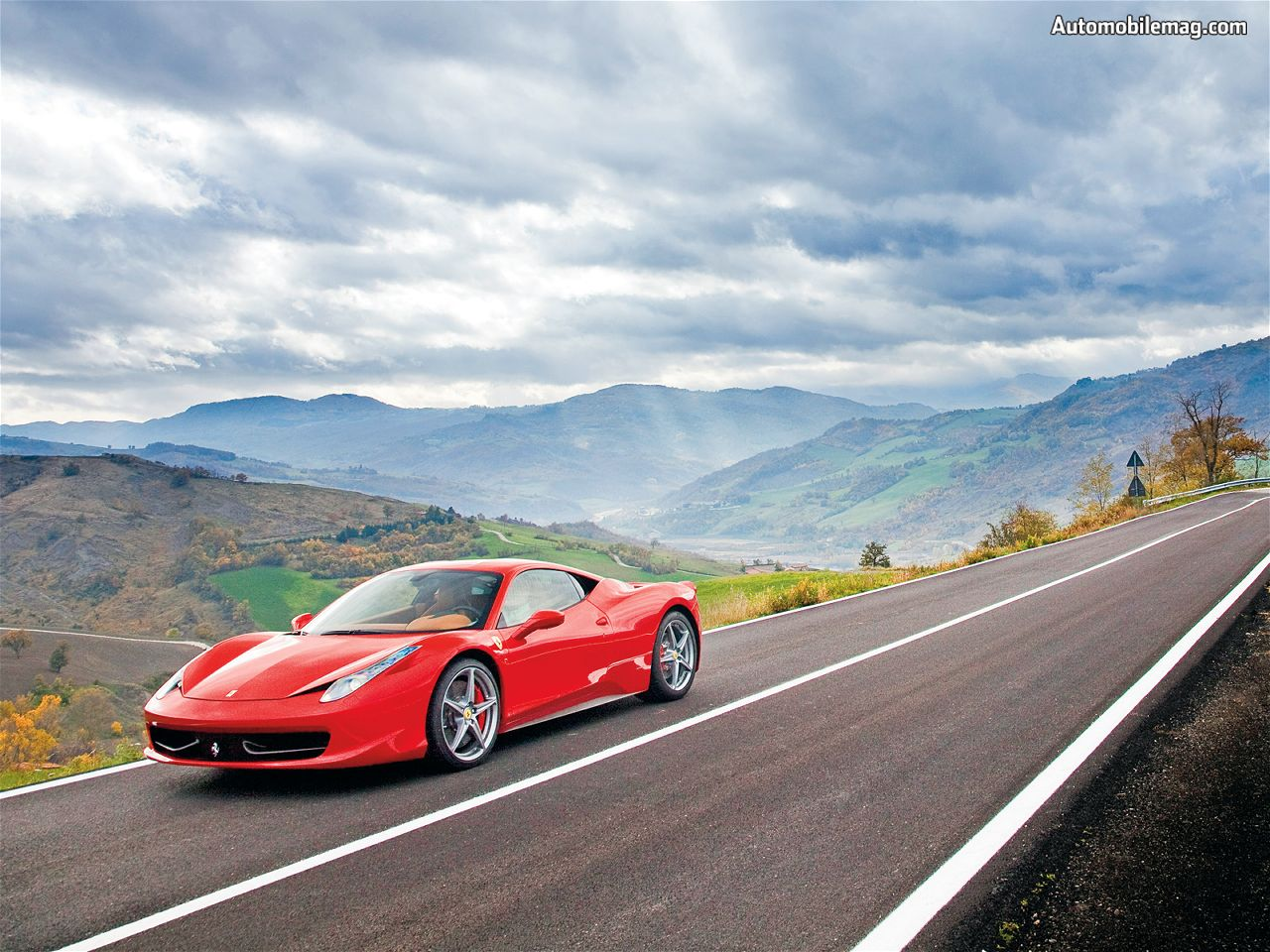 Ferrari road cars are used as a symbol of luxury and wealth for Wallpaper italia