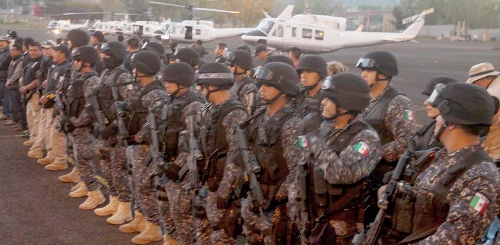 Michoacan Bajo Fuego.  Fotogaleria.  Las Victimas de Paracuaro Armadas01