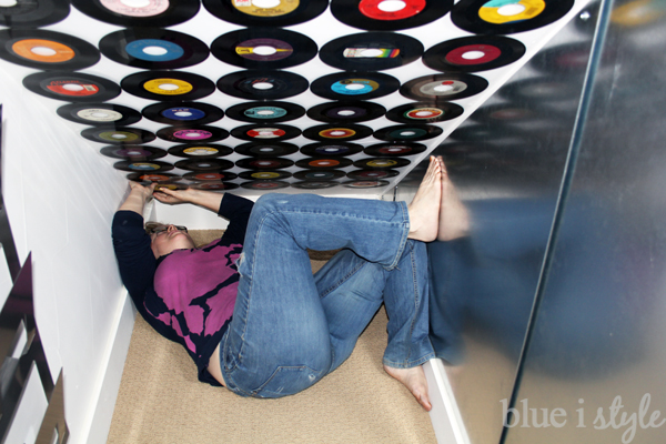 Affixing records to ceiling wall