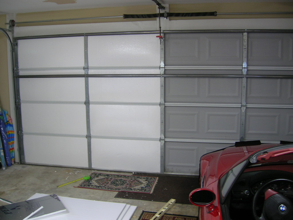 Living stingy insulating your garage door for cheap garage door manufactures want hundreds of dollars for an insulation kit a new insulated garage door can cost thousands for about 100 you can insulate rubansaba