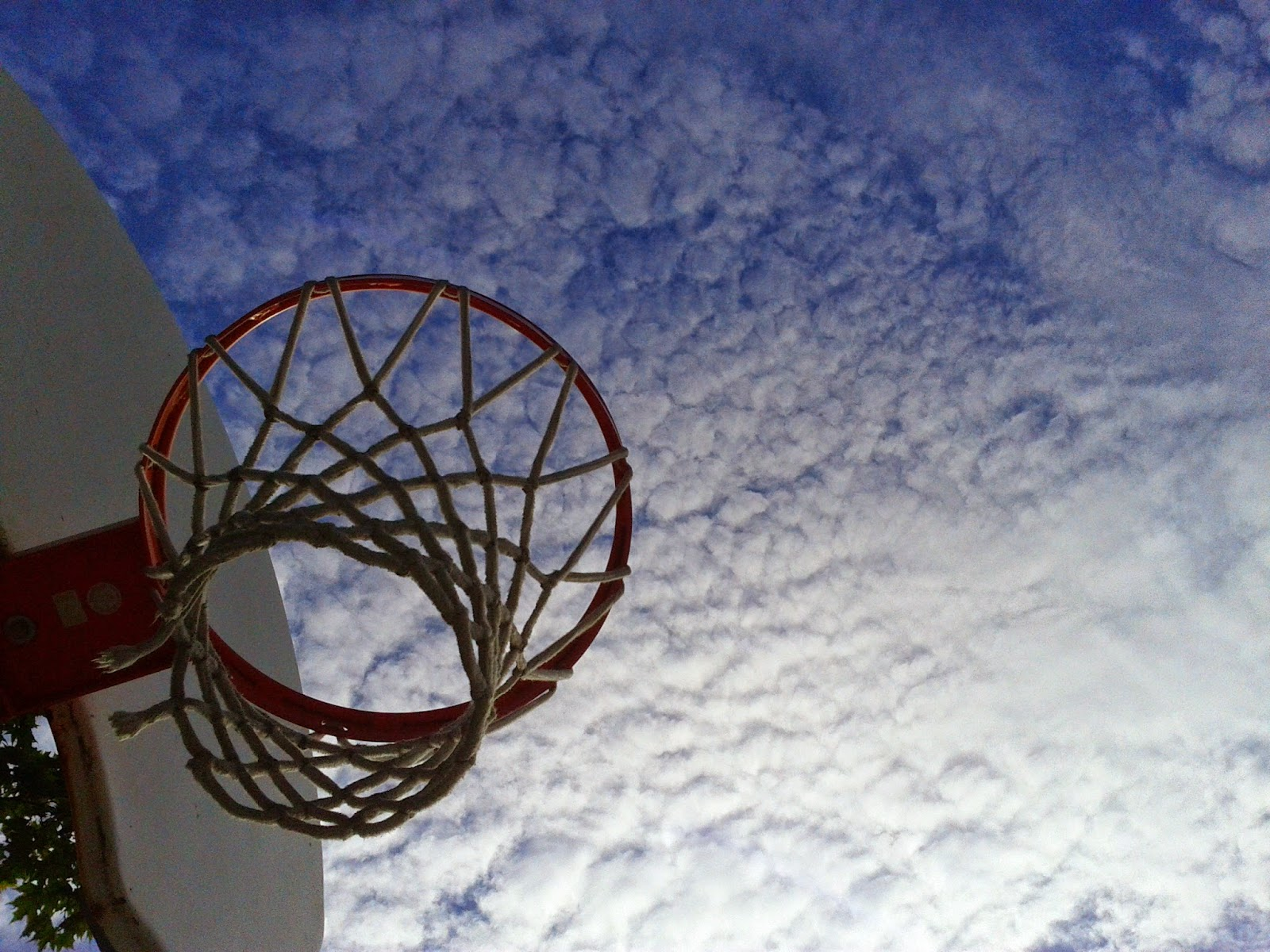 Stock photo: Basketball rim, backboard with clouds in the background (outdoor)