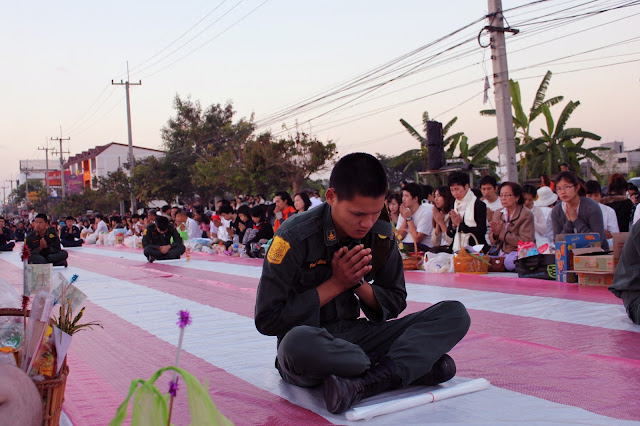 Monks alms-giving in Chiang Mai, praying, military cadets