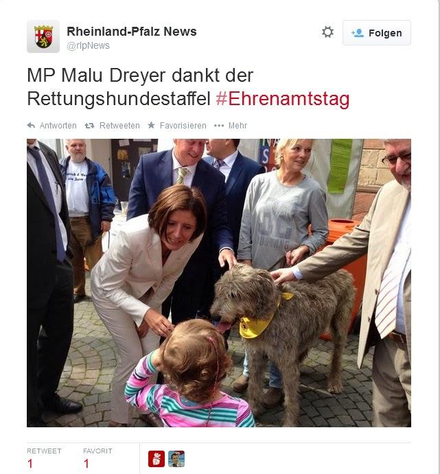 Malu Dreyer mit Hund und Kind