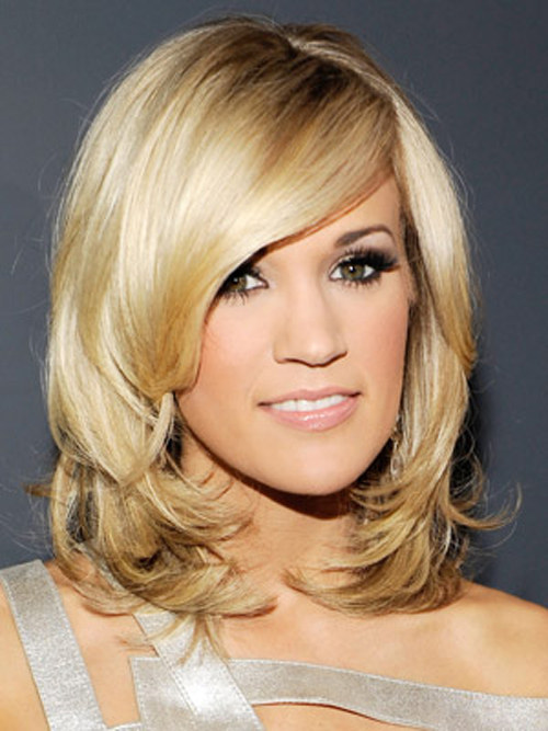 Carrie Underwood's swoopy bangs and sultry side-part polish off her lustrous bob.