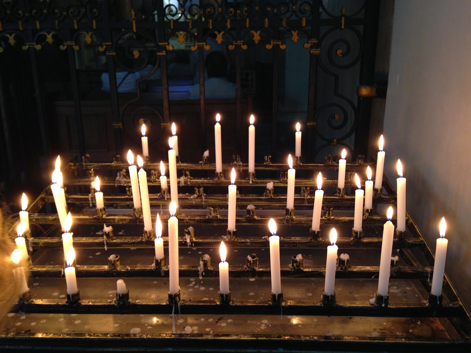 Candles in the All Saints Church on Grzybowski Square by Maja Trochimczyk