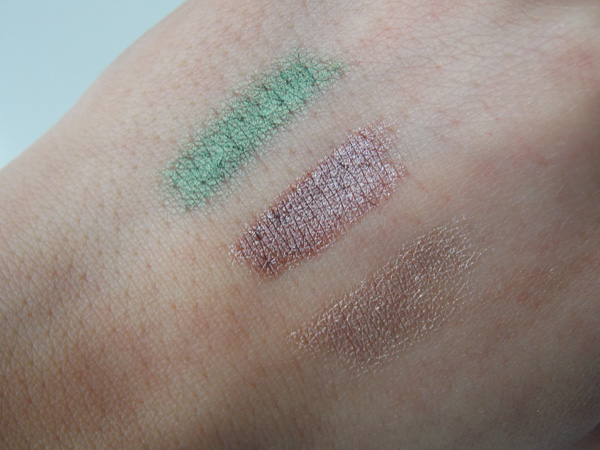 Mally Age Rebel Eyeshadow Sticks Swatches - Sugar (light champagne), Burnished Voilet (shimmery brown) and Jade (emerald green)