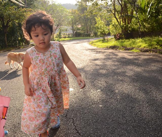 Kecil walking in the sun