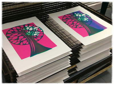 Trees on top of pink test print paper