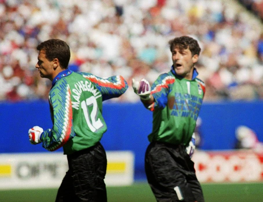 In this Thursday, June 23, 1994 file photo, Italy's goalkeeper Gianluca Pagliuca, right, passes substitute keeper Luca Marchegiani, left, as Pagliuca leaves the field of play after receiving a red card during the World Cup Group E opening round soccer match against Norway, at Giants Stadium in East Rutherford, N.J. On this day: Italy's Pagliuca becomes the first goalkeeper to be sent off in a World Cup finals match. Italy still prevailed 1-0.