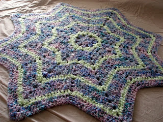 multicolored purple and green star-shaped baby blanket