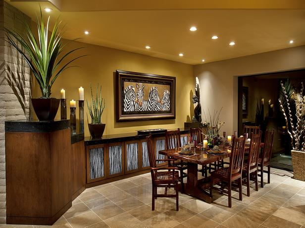 this african inspired dining room has custom designed walnut cabinetry