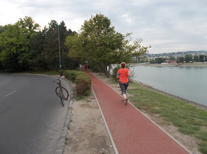 Morning Joggers and jogging track on Margaret Island in Budapest.