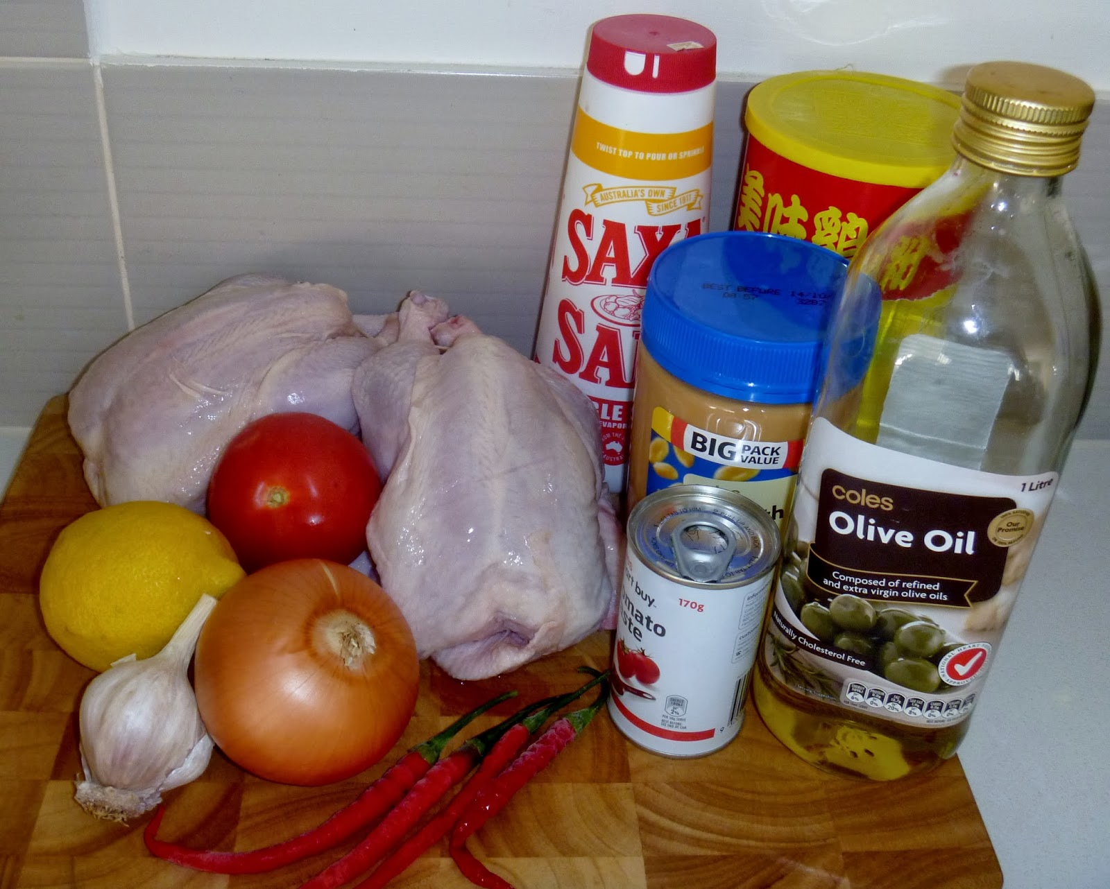 Pepper chicken sierra leonean recipe the cooking wardrobe 2 small sized whole chicken 4 tbs olive oil 3 tbs peanut butter 2 tbs tomato paste 1 medium fresh tomato 1 brown onion 1 lemon 4 cloves garlic forumfinder Image collections