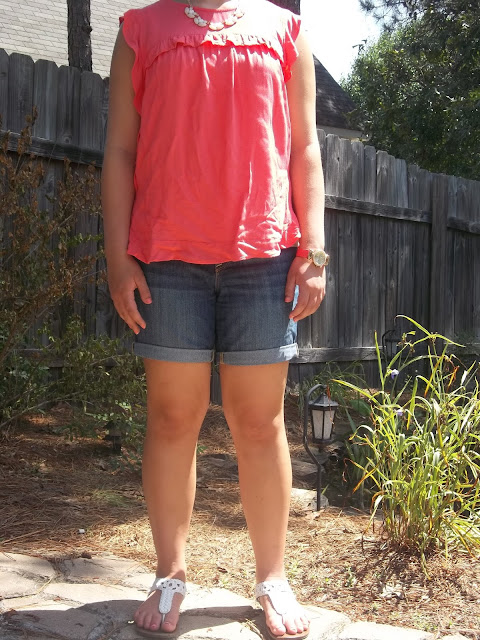 coral blouse, jean shorts, statement necklace, white sandals, watch. outfit