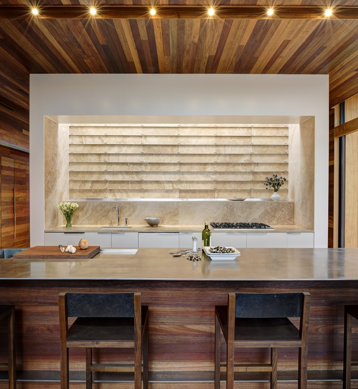 Kitchen island in Sam's Creek Home by Bates Masi Architects