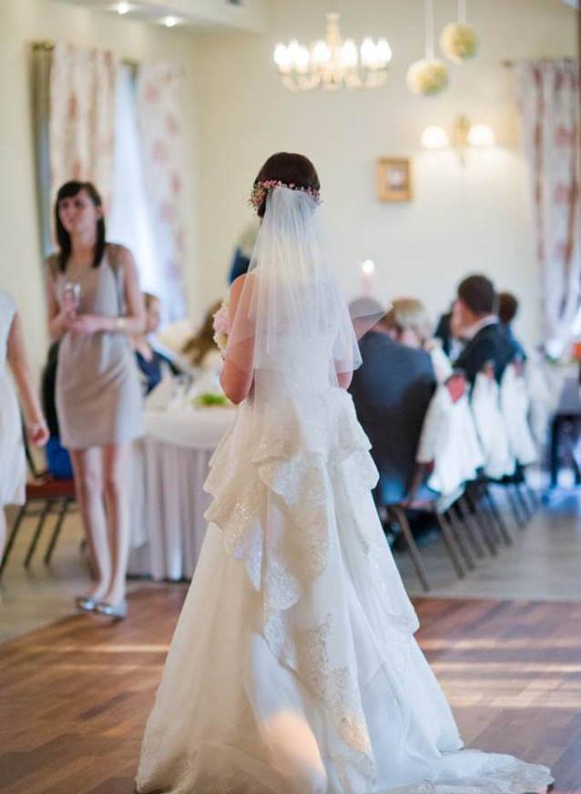 Romantyczna suknia ślubna z koronkami