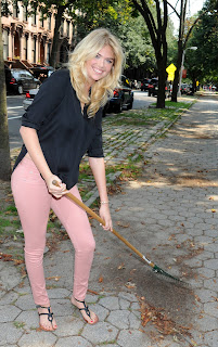 Kate Upton in pink pants cleaning leafs