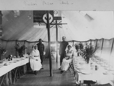 Nursing Sister WW1 Photo Album: 28V Sisters in Mess Tent check flowers
