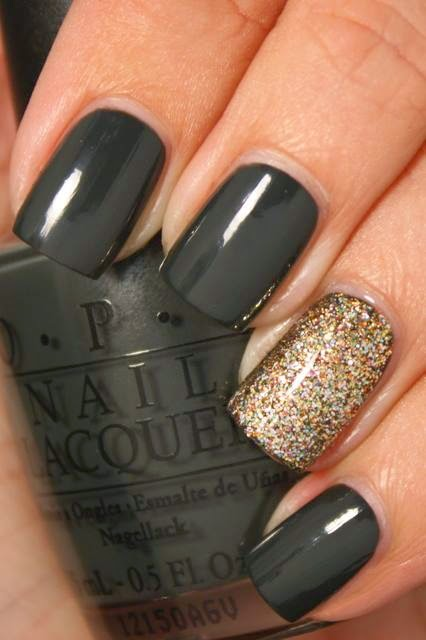 Gorgeous Black Nailvwith Golden Gulliter Nail Art Combination For