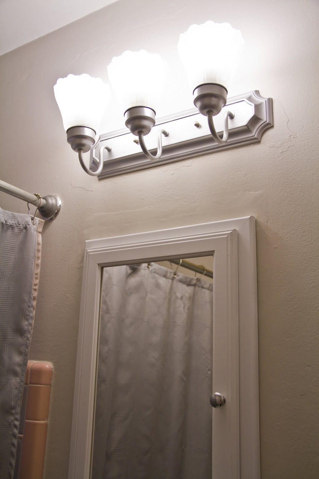 Swingncocoa pink bathroom chronicles vanity light for Lighting for a bathroom