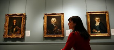 A woman looks at paintings, Jean-Marc Nattier Portrait of a Commander of the Order of the Knights of Malta, from The Collection of Louis La Caze at The Wallace Collection, in London