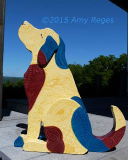 zen dog red, yellow, blue painted with tangle designs
