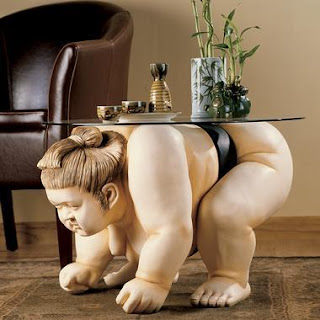 Sumo wrestler table is almost nude