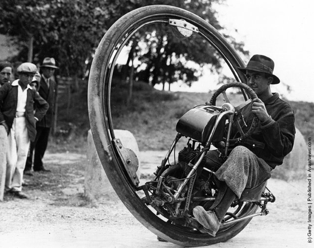 "Swiss engineer M. Gerder at Arles, France on his way to Spain in his ""Motorwheel"", a motorcycle with a wheel which runs on a rail placed inside a solid rubber tyre. (Photo by Fox Photos/Getty Images). 1st September 1931"