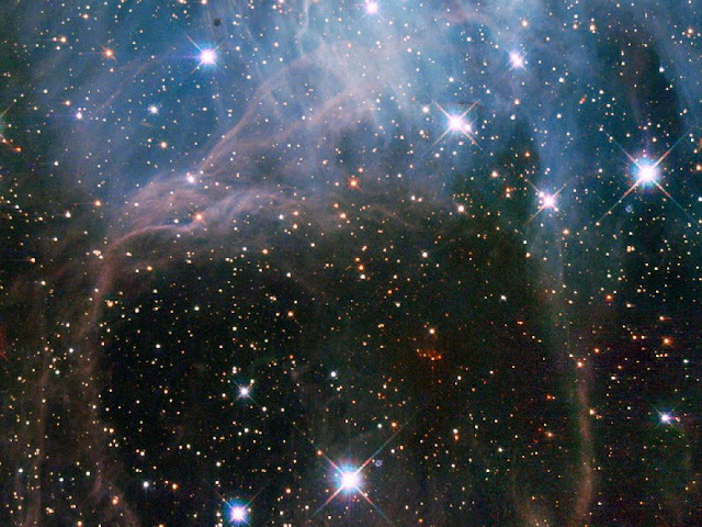 Imagens de do conglomerado de estrelas NGC 2040 ou LH 88 - localizado na Grande Nuvem de Magalhães