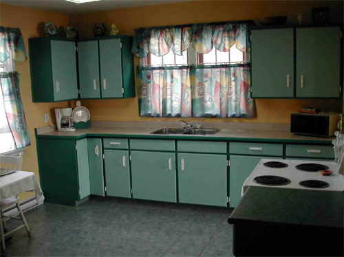 Teal painted kitchen cabinets for Teal kitchen cabinets