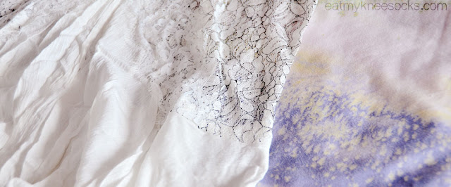SheInside's lace shift dress is a cute, romantic white dress with long sleeves, a stand-collar design, and cute cutouts.